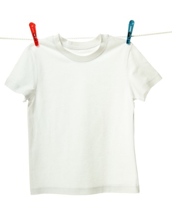 White shirt hanging on the clothesline. Image isolated on white background