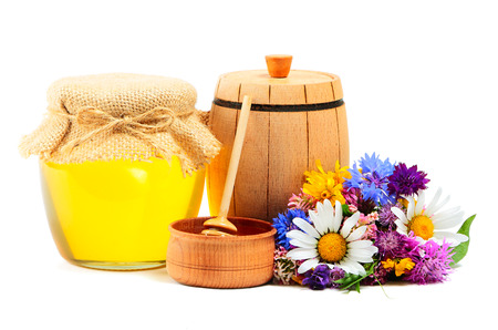 miscellaneous: May honey in jar with miscellaneous flowers on white background