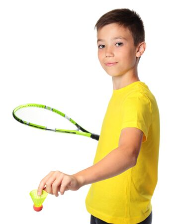 Ten years old boy with tennis racket isolated on white background
