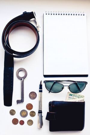Overhead view of men's casual outfits, Essential vacation items on the white background.