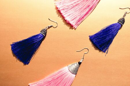 Fashion earrings tassels. Two pairs of pink and blue earrings tassle. Fashion concept.