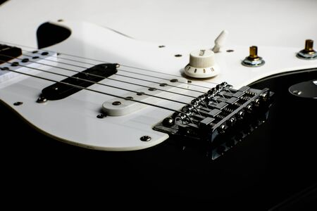 Detail of electric guitar body close up, selective focus. Black and white rock guitar. Banque d'images - 129037326