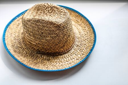 Vintage straw latin american or cowboy hat on white desk. view from above.