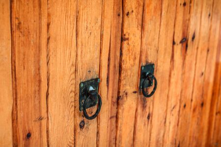 Old wooden gate with forged handles