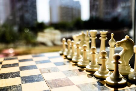 White chess pieces on a chess board. Two chess teams one in front of other on the board. Black and White chess setup . Leader and teamwork concept for success. concept strategy. competition and battle 写真素材