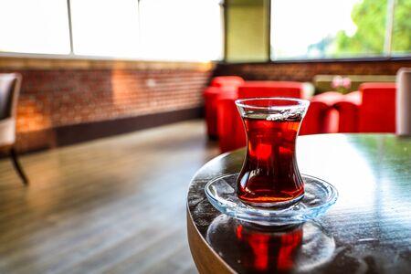 Turkish black tea on a cafe table, close up. Traditional turkish tea on the wooden table in a cafe.
