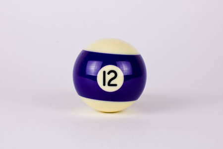 Shiny dark blue white ball number 12 for billiard isolated on white background. High quality photo
