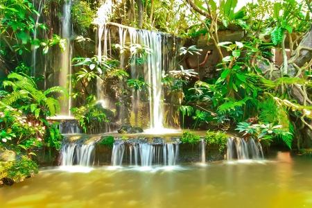 Beautiful tropical man-made garden waterfalls photo