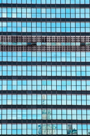high rise: The United Nations building glass window with Chrysler building reflection  in New York City Stock Photo