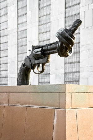 non violence: Gun tied in a knot Non Violence  a sculpture by Fredrik Reutersward at the United NationsUN headquarters as symbol for reaching peace Stock Photo