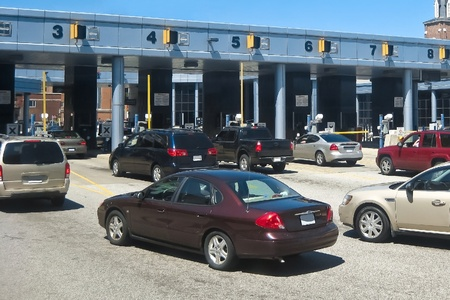 turnpike: Highway toll payment booth traffic Editorial