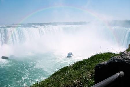 Beautiful rainbow over tour boat at Niagara falls horseshoe