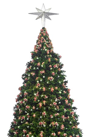 Christmas tree with decorations and silver star at the top white background photo