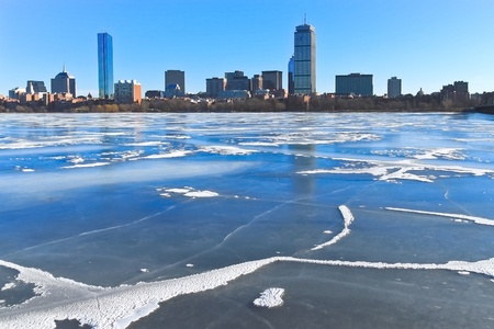 Frozen Charles river and Boston skyline in winter photo