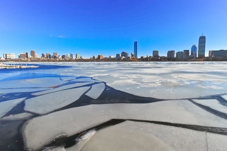 Cracked ice on frozen Charles river with Boston skyline background photo