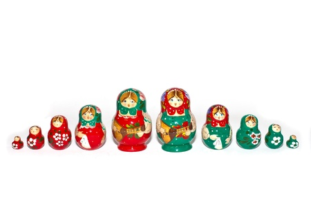matryoshka: Red and Green Russian Dolls in Single Row isolated on white background Stock Photo