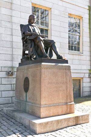 John Harvard statue. Tourists rub his left shoe for luck