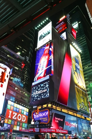 NEW YORK CITY - JAN 23: Times Square, a busy tourist intersection, featured with Broadway Theaters and animated LED signs is a symbol of New York City and the United States on January 23, 2010 in Manhattan, New York City.  Stock Photo - 12272339