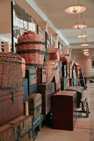 NEW YORK - JAN 21 :Old immigrants baggage at the Ellis Island Museum on January 21, 2010 in New York. Ellis Island, the gateway for immigrants to USA, was immigrant inspection station from 1892 to1954