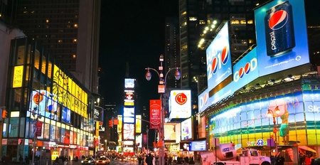 NEW YORK CITY - JAN 21: Times Square, a busy tourist intersection, featured with Broadway Theaters and animated LED signs is a symbol of New York City and the United States on January 21, 201 版權商用圖片 - 12272338