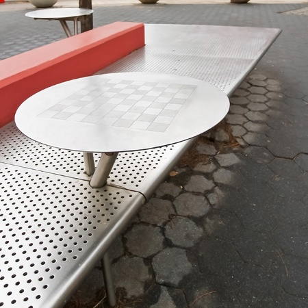 Outdoor stainless steel chess board table and the bench Stock Photo - 12575566