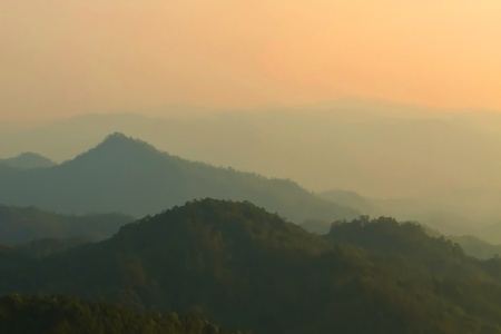 Morning mist and layers of tropical mountain at Huai Nam Dang National Park in Mae Hong Son, Thailand  photo