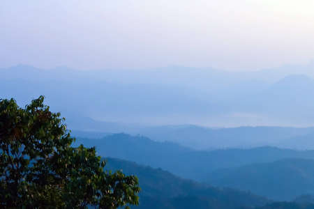 Morning mist and layers of tropical mountain at Huai Nam Dang National Park in Mae Hong Son, Thailand Stock Photo - 12577049