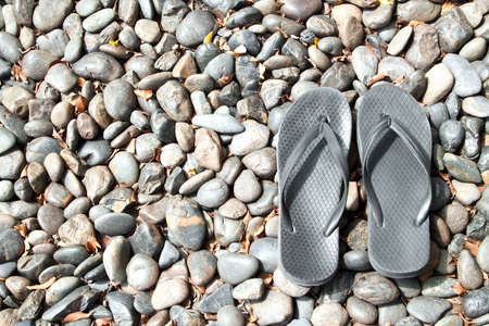 Flip flops on pebble stones photo