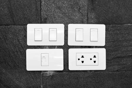 grounded plug: Four white wall mounted electrical plates