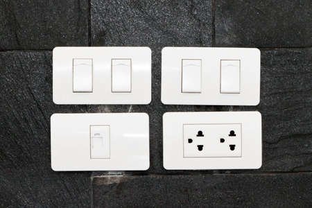 Four white wall mounted electrical plates photo