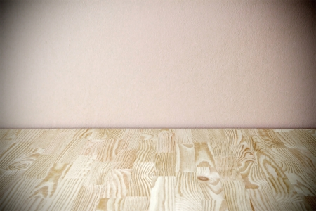 Empty grunge vintage pale pink room with wooden floor  Stock Photo - 14789137