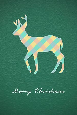 Colorful Christmas reindeer on green background photo