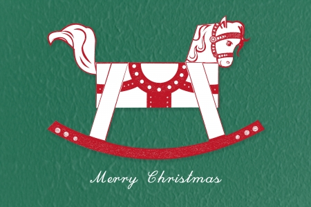 Abstract red and white rocking horse Christmas greetings on green background photo