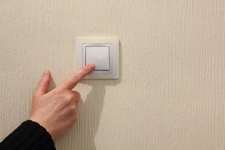 off: Electrical switch. Hand. Stock Photo
