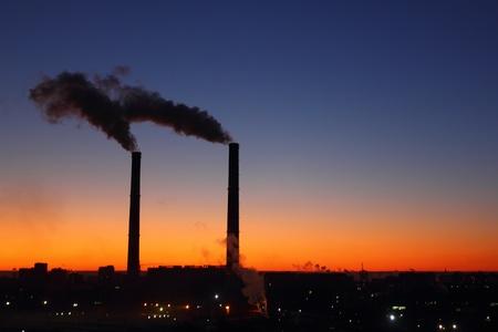 Smoking factory chimneys. Sunrise.