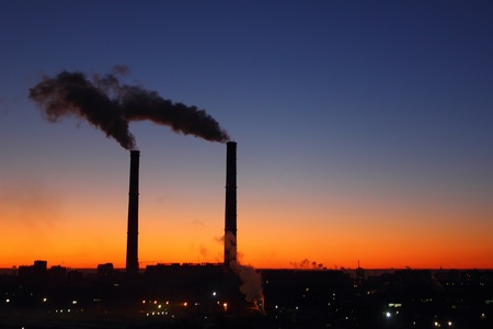 incinerator: Smoking factory chimneys. Sunrise.