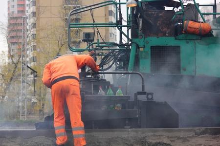 Road workers. The asphalt.