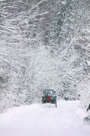 Winter road  Tractor   photo