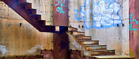 forgotten: Forgotten rusty stair in brownfield Editorial