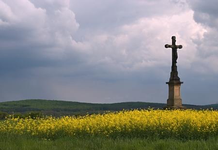 inri: Wayside cross in a field under dark sky