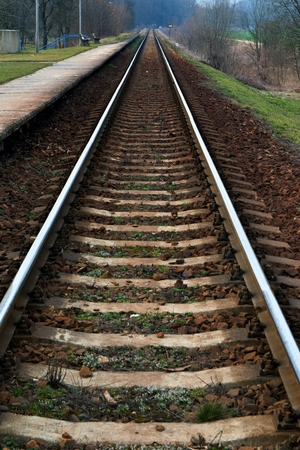Straight railroad track connecting in perspective