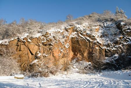 Snowy rock under blue sky