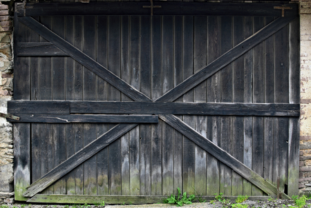 Old black wooden gate Stock Photo