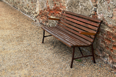 Abandoned wooden bench in the street Stock Photo