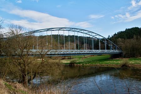 Steel truss bridge over the river