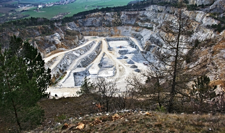 Large industrial quarry in the valley Stock Photo
