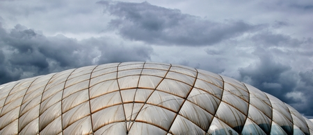 An inflatable hall under the dark sky with clouds