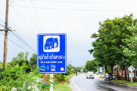 guidepost: Guidepost to the elephant village. Stock Photo
