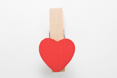 hanged woman: Wooden pin with heart shaped