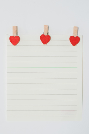 missive: Note with the heart-shaped pins. Stock Photo